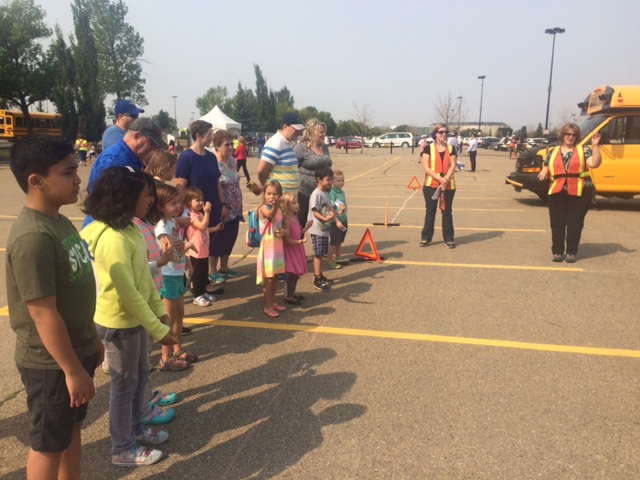 Children and families learn to ride the bus safely